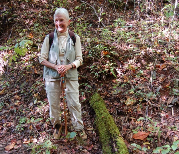 Ann with mossy chestnut log, from a tree that died of blight nearly a century ago.