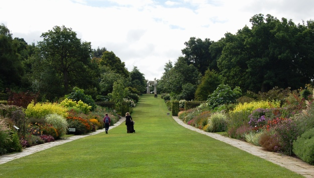 The mixed borders and grand view up Battleston Hill at RHS Wisley.