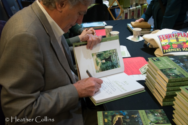 Gordon Hayward, kick-off speaker, signing Art and the Gardener at his book table.