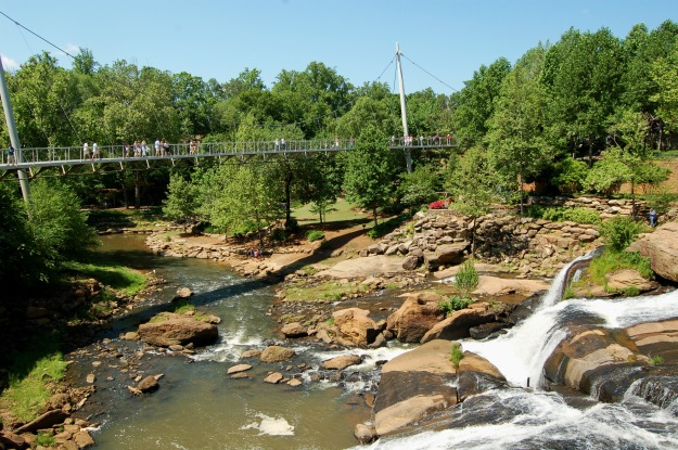 Pedestrian bridge over the falls at Greenville's Fall Park.