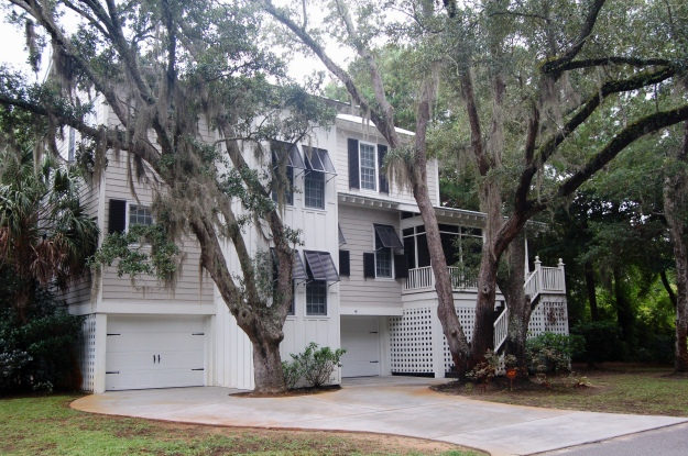 A South Carolina Lowcountry-style beach house with oaks cloaked in Spanish moss.