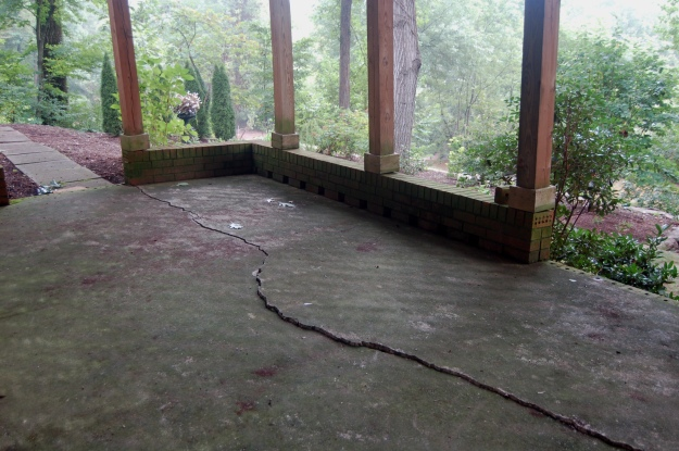 Crack in the patio that is the foundation for the unwanted deck.