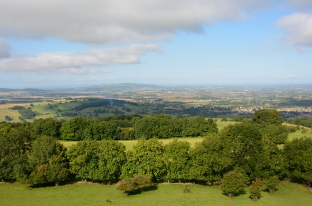 In the far distance looking west, the counties of Hereford, Worcestershire, and Powis, with the Malvern Hills 25 miles distant.