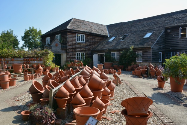 Some of the large flowerpots available in the stockyard between the Pottery production building, shown here, and the Octagon Gallery.